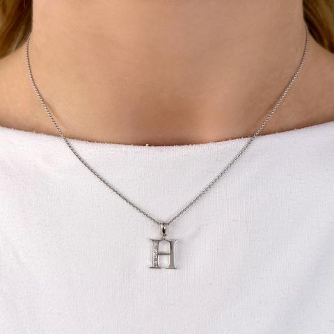 Letter h hanger in 14 caraat witgoud 0,04 ct