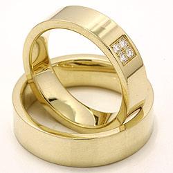 Mooi brede diamant trouwringen in 14 karaat goud 4 x 0,0165 ct - set